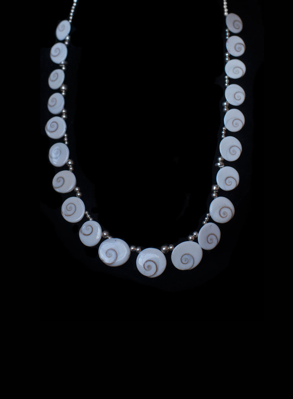 Multi-operculum necklace with silver beads. Necklace length- 45cm.