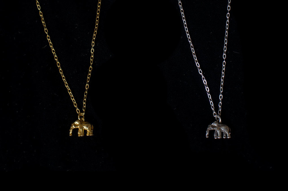Elephant with chain. Silver & silver gold plate. Chain length- 55cm. Pendant height- 1cm. Width- 1.5cm.