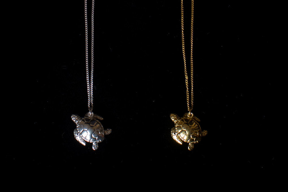 Turtle with chain. Silver & silver gold plate. Chain length- 46cm. Pendant height- 1.5cm. Width- 1.5cm.