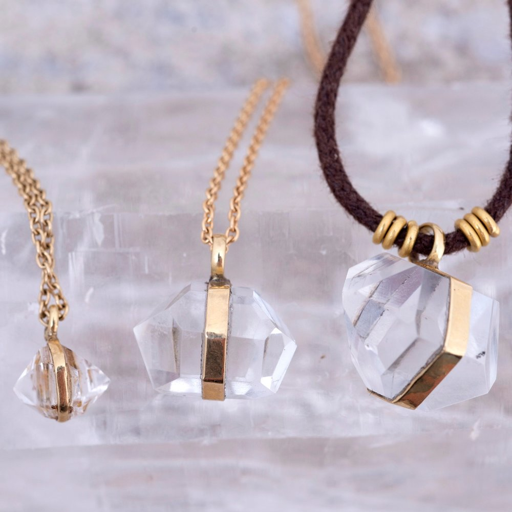Terminated Crystal Pendant Necklace, in different shapes and sizes. Available in silver and gold.  Email us  for price-list and to view images of our current stock.