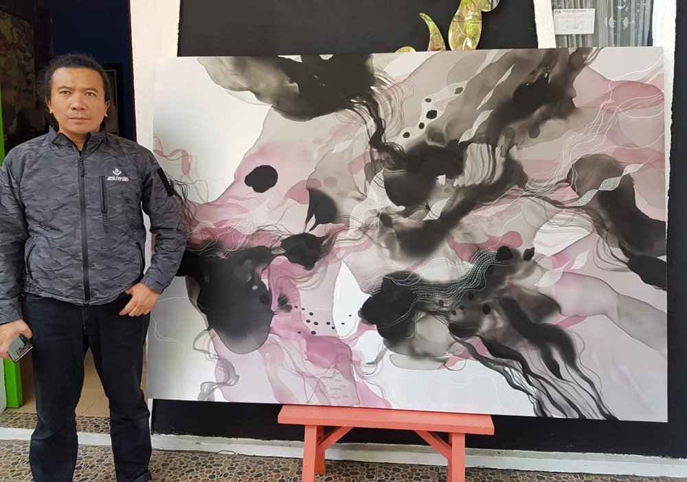 Indonesian artist John Martono with  Untitled,  2018, Paint on Silk with Hand Stitching, commissioned for The Capitol Kempinski Hotel, Singapore.