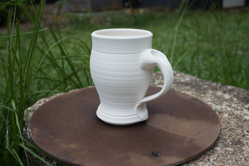 Barrel Mug - This mug features a rounded figure and holds over 16 oz.  This is also the perfect shapes for those who love to cradle their coffee in the morning (you know what we are talking about!)