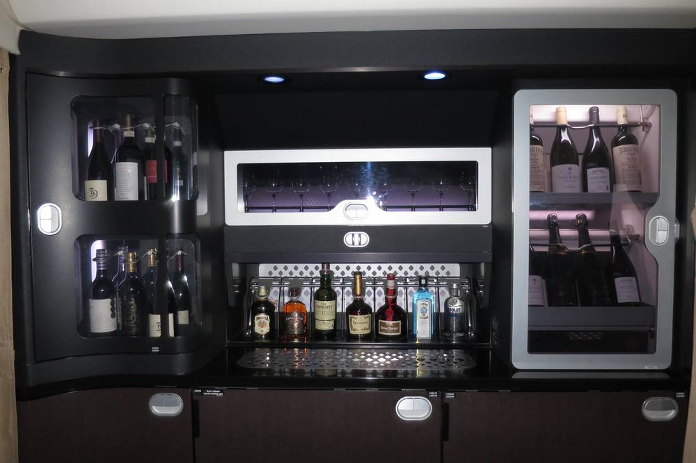 Some of the alcohol selection by the lounge