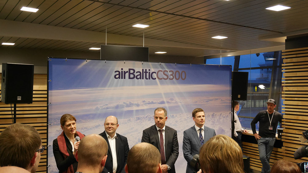 airBaltic execs and the Latvian ambassador to the Netherlands giving a speech