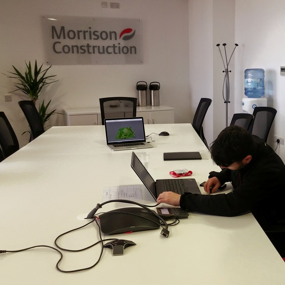 Michael setting up before the Aura team presented to staff at Morrison Construction following an aerial drone survey for a high school site in East Lothian. We produced a Cloud Model using photogrammetry which was subsequently used by the architect for planning. We've since delivered a number of other aerial surveys for High School sites.    Click to find out more about our aerial drone survey services