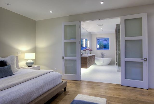 French doors lead to a gorgeous ensuite master bath you won't ever want to leave. Grab your favorite book and fill up a bath - don't skimp on the bubbles! #basalt #colorado #masterbathroom #masterbedroom #home #house #architecture #design #architecturaldesign #interiors #interiordesign #housegoals #lifestyle #luxurylife #luxurylifestyle #luxury #luxuryrealestate #luxuryhomes #archdaily #architizer #architecturaldigest #highclasshomes #archicad #bimx #graphisoft #kadesignworks