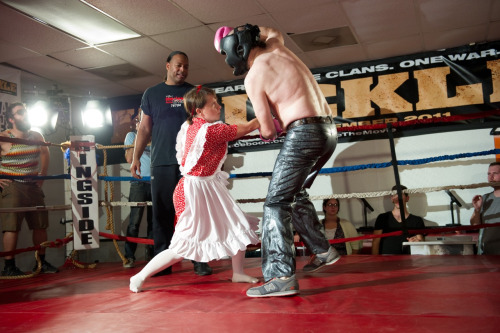 Rebecca dressed as a child robot boxing Nathan Zellner at an Alamo Drafthouse film event.