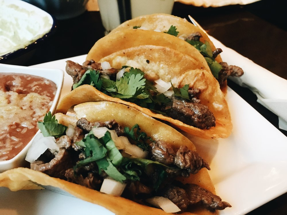 Steak tacos in crispy corn tortillas...