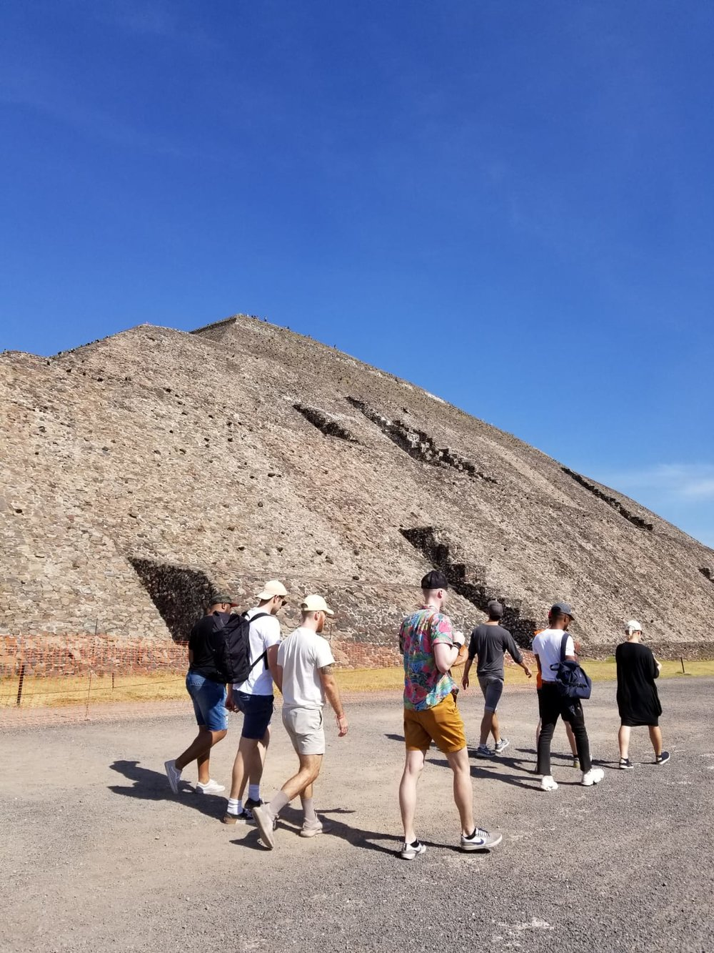 Walking next to the temple of the sun at the Teotihuacan Pyramids.