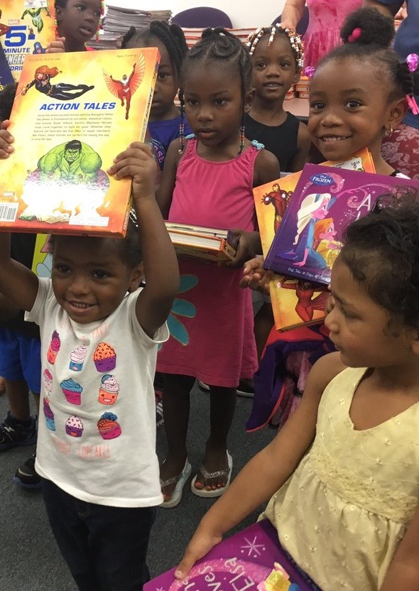 kids take their pick of free books to bring home for summer learning day. the hope is to offset summer learning loss and to get them ready for the upcoming school year.