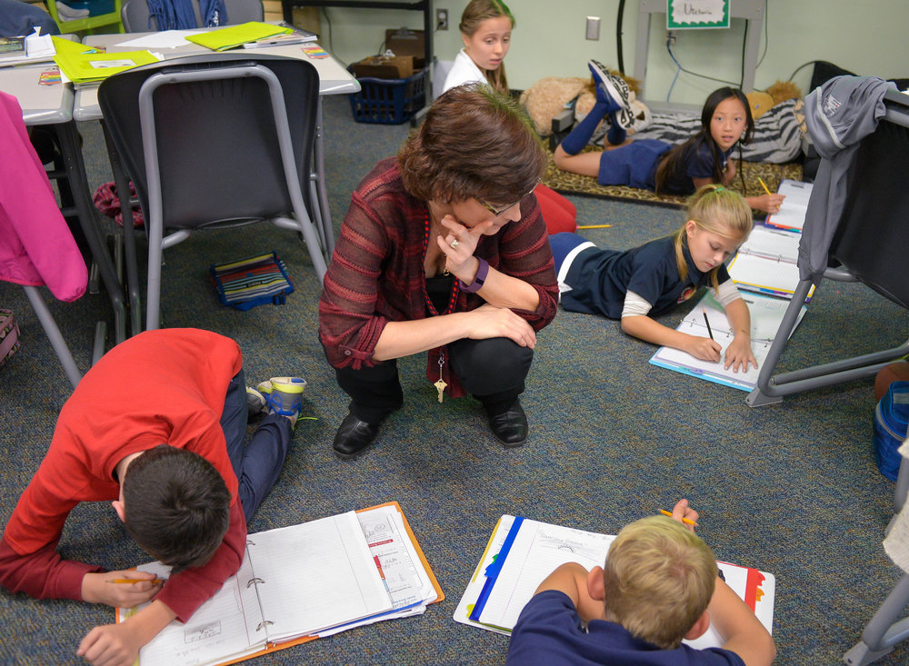 "Students engage in ""belly writing"" in Sandy Waite's class at Southside Elementary School on Friday. Herald-Tribune staff photo / Dan Wagner"
