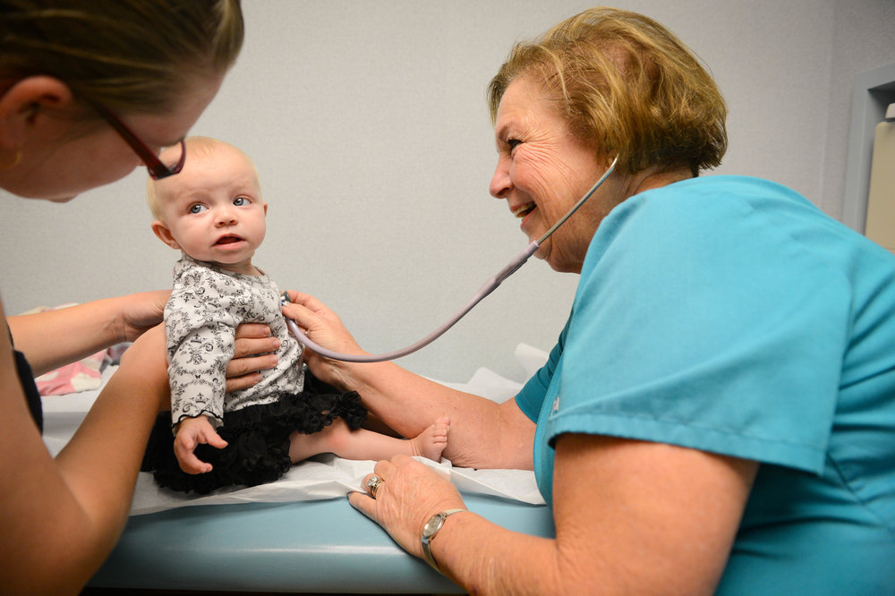 Pediatrician Dr. Carola Fleener conducts a checkup at her Sarasota Children's Clinic.