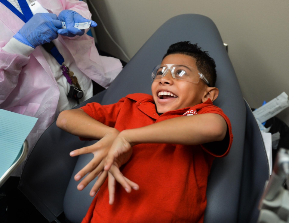 Gocio Elementary School second-grader Xavier Del La Cruz is all smiles while getting dental sealant at the school on Friday. Herald-Tribune staff photo/Dan Wagner.
