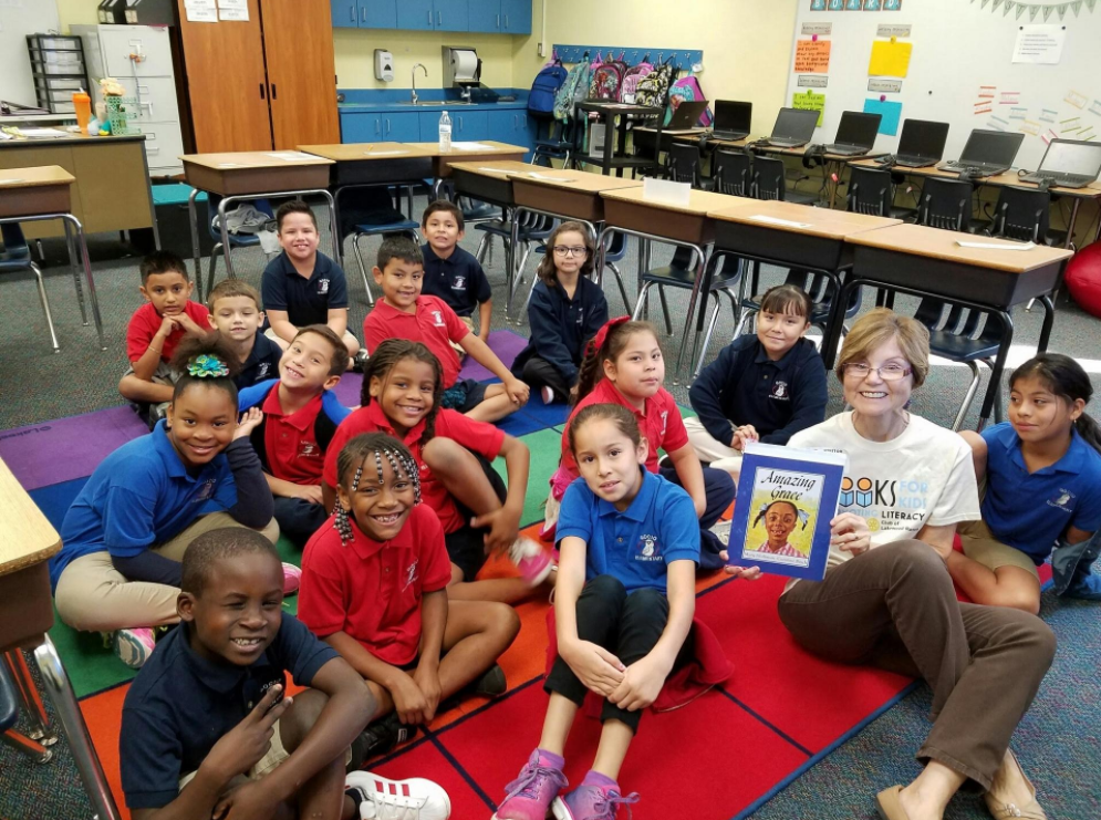 Bobbi Bordes, a volunteer with the Books for Kids organization, reads to a group of children at Gocio Elementary School in Sarasota. Photo courtesy of Ted Lindenberg.