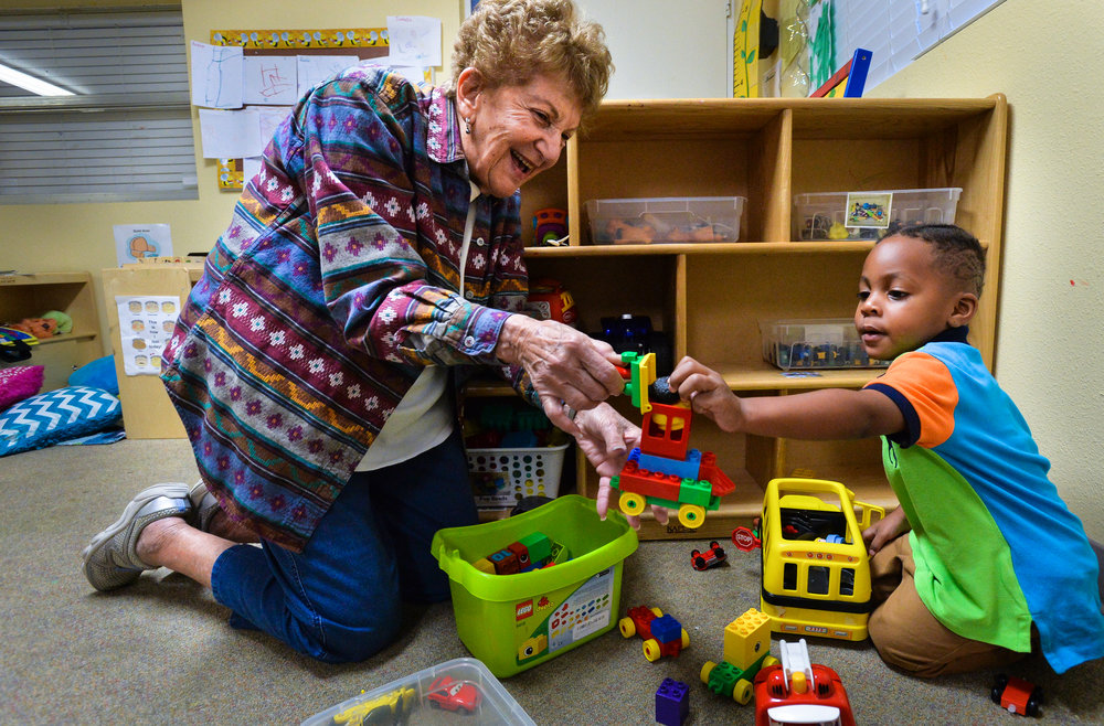 Volunteer Rita Fenichel, 88, plays with three-year-old Joseph Graham at the Florida Center for Early Childhood. Herald-Tribune staff photo / Dan Wagner