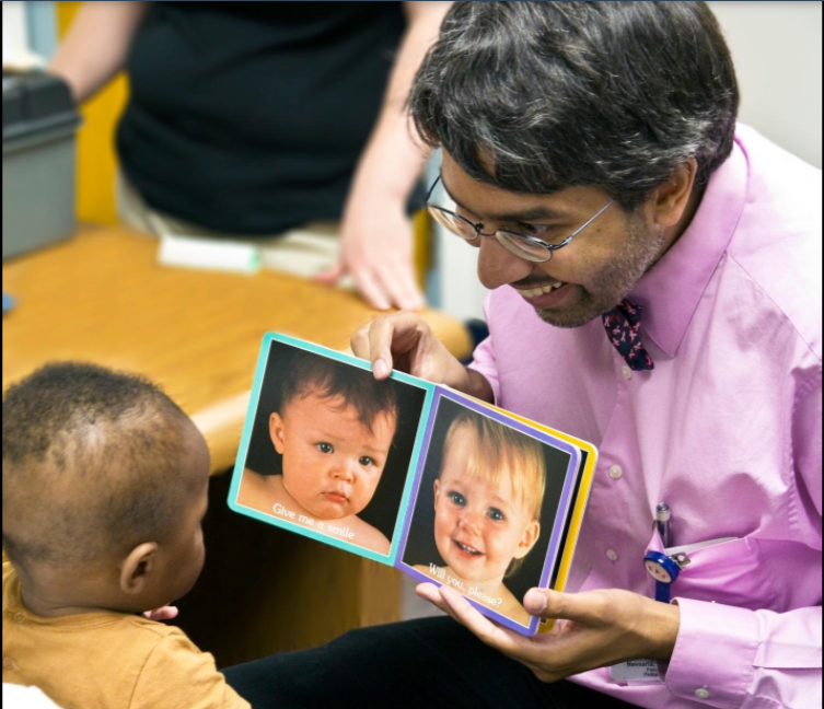 Dr. Dipesh Navsaria pictured with a young patient. COURTESY PHOTO/PARKER HOERTZ.