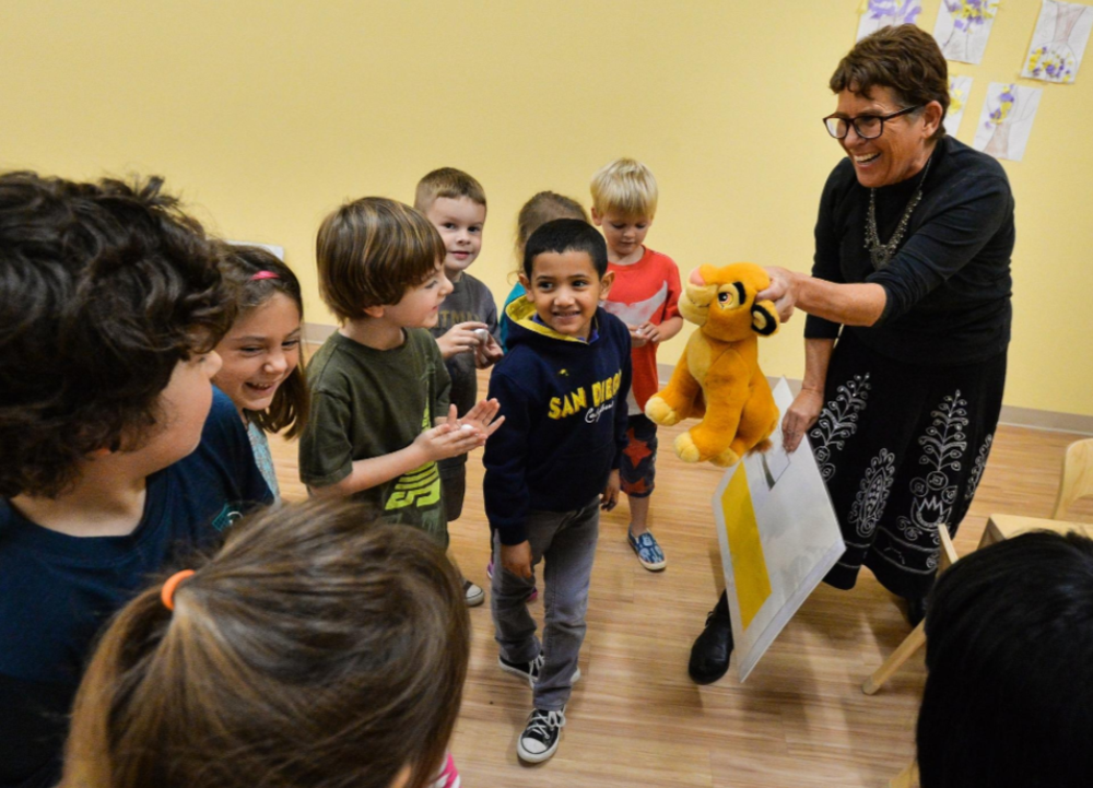 "Prekindergarten teacher Deborah Kaufman leads her students through a scene in the book ""Mouse Paint"" at Temple Emanu-El Early Learning Center. In an innovative literacy program, preschoolers literally walk through scenes from books to keep them engaged with the story. [Herald-Tribune staff photo/Dan Wagner]"