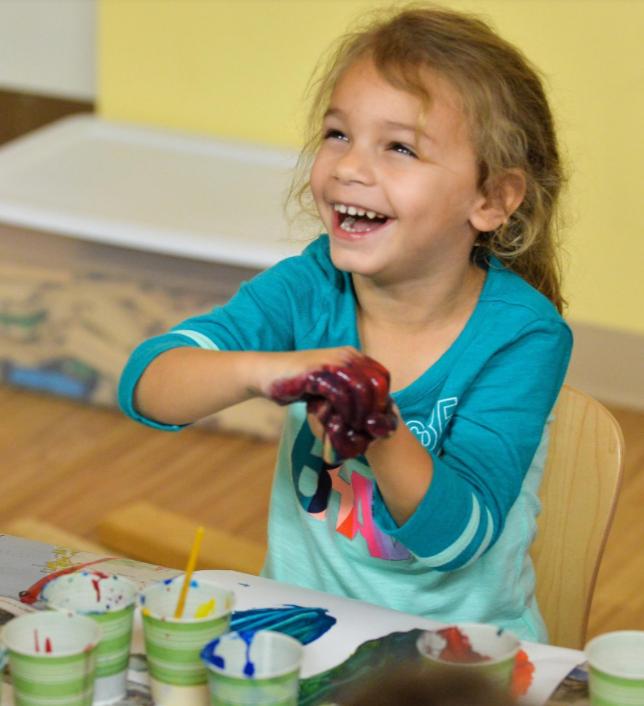 "Prekindergartener Ariahna Marano mixes finger paints, a scene from the book ""Mouse Paint."" [Herald-Tribune staff photo/Dan Wagner]"