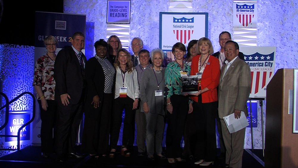 Participants in the Suncoast Campaign for Grade-Level Reading accept the All-America Cities award in Denver, Colorado, on Friday, June 16, 2017. [Bill Wagy / SCGLR]