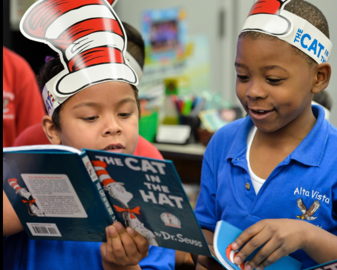 Alta Vista Elementary School first-graders Dylan Sanchez, left, and Pierre Lubens read the classic tale by Dr. Seuss. While Florida children struggle with poverty, the state performed better in education indicators than other states, according to the latest Kids Count annual report from the Annie E. Casey Foundation. [Herald-Tribune archive / Dan Wagner]