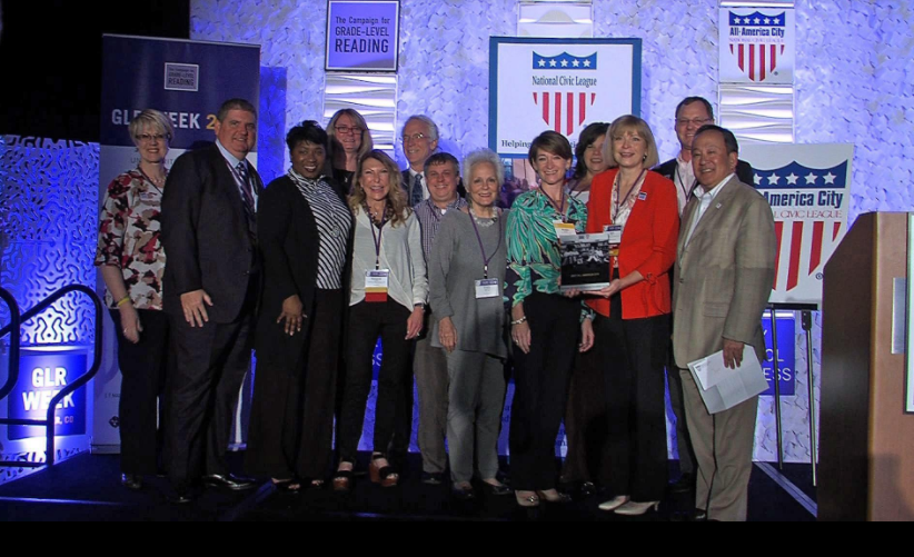 Coordinators and partners with the Suncoast Campaign for Grade-Level Reading accept the All America City Award in Denver in June. [Courtesy photo/Bill Wagy].