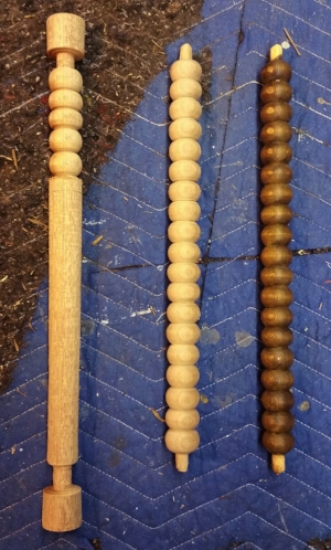 A duplication of a spindle from a 19th century corner stool. The original piece (right) the duplication (middle) and a second spindle in process (left)