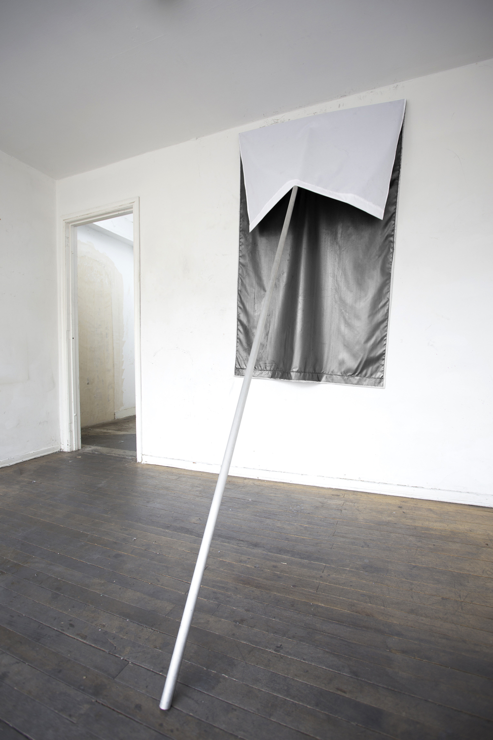 Santiago Reyes Villaveces  ©  2014 ,  Flag . Wood, graphite and fabric. 98.4 x 39.3 x 59 in (250 x 100 x 150 cm). Courtesy of the artist.