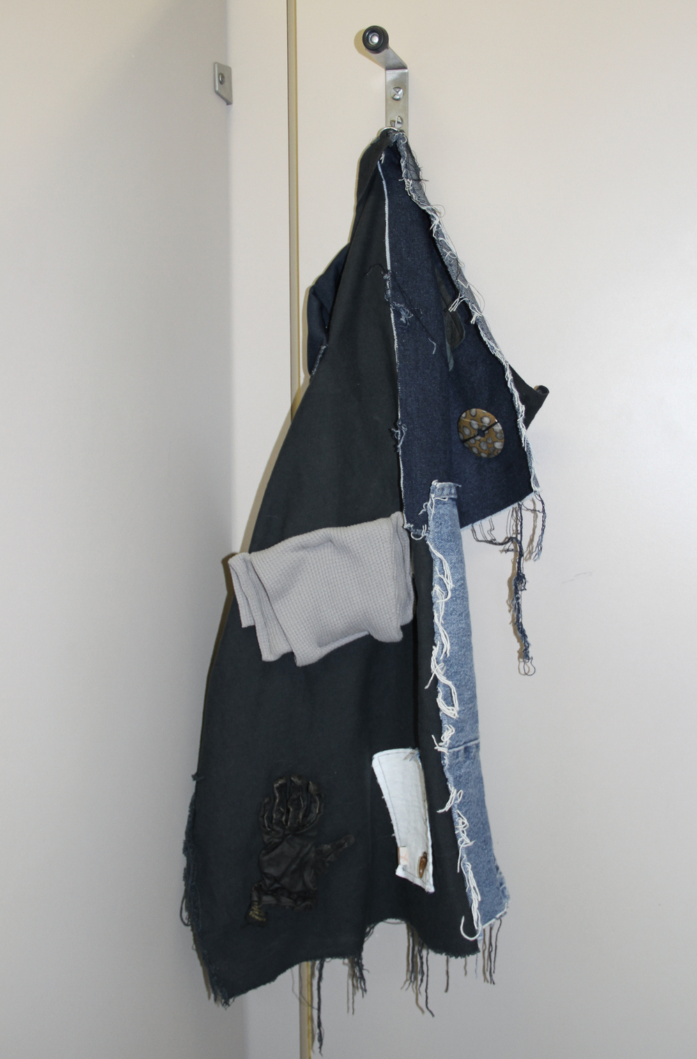 Catherine Czacki © 2016 ,  Not a Master, part III . Denim, leather, beads, stone, plastic, paint. 34 x 17 x 17 in. *Accompanied by text: Open. Courtesy of the artist.