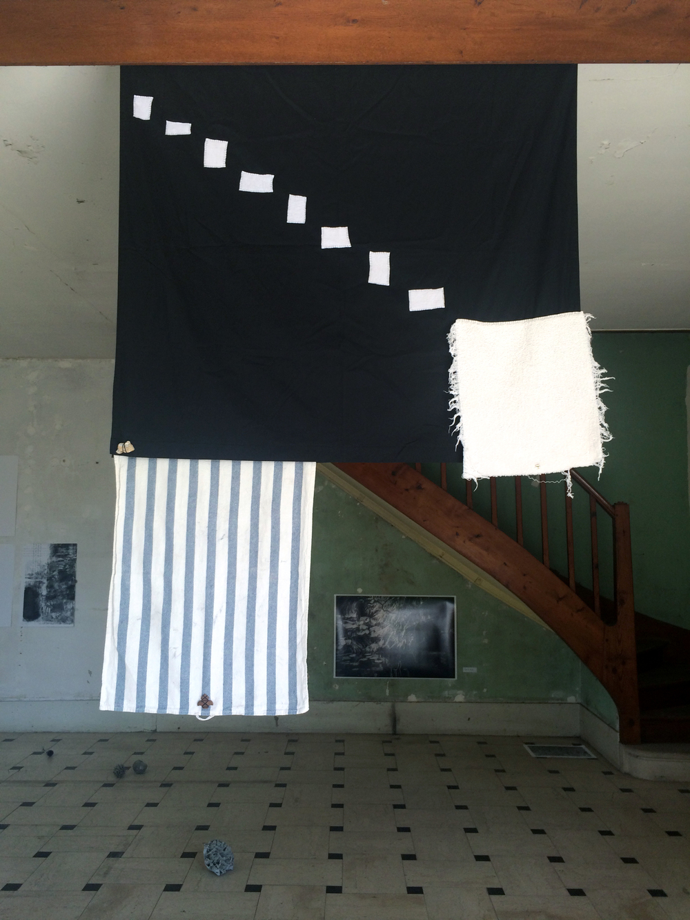 Catherine Czacki © 2015 ,  Start with death and work backwards  (Installation).  Low Plane Flag . Fabric, stone, metal, shredded towel, leaf. Dimensions variable. *Accompanied by text: Start with death and work backwards. Courtesy of the artist.