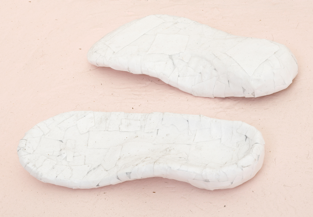 Catherine Czacki © 2015 ,  Contour Mimic . Orthopedic sandals, papier mache - fabric, acid free paper, PVA glue. 10 x 3 x 10 in. *Accompanied by text: OBJSUBJ. Courtesy of the artist. Photo: Office Hours and Jeff Mclane.