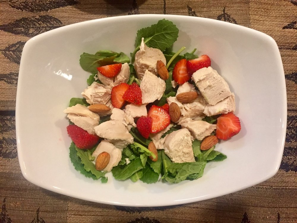 - 3 oz chicken breast (free range-humane- Costco)1/2 cup organic Strawberries (Trader Joes)7-8 whole Almonds (Trader Joes)2 cups of Traders Joes mixed organic Greens (kale and spinach)Olive oil (Tbs) and salt to taste