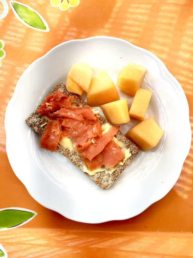 "smoked salmon, butter, mango and ""knecke brot"" (whole grain cracker thing)"