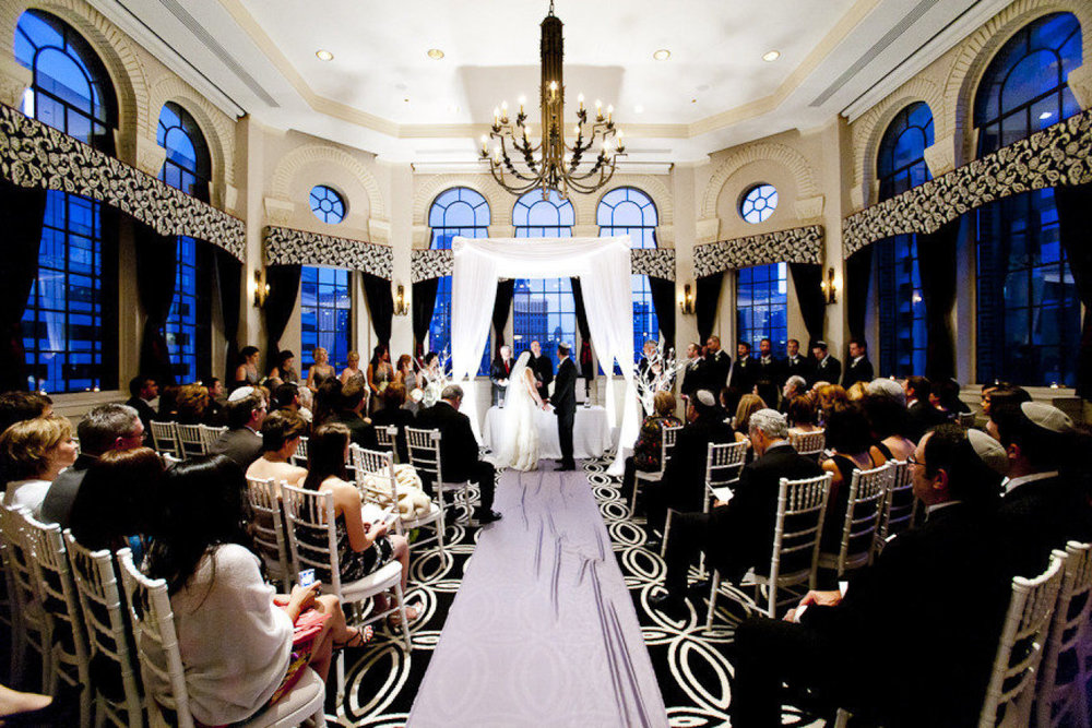 We love how the simple white chuppah plays off the black and white of the room.