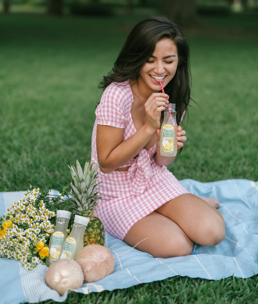 Caila Quinn with tropicana Made-to-go Pineapple coconut water