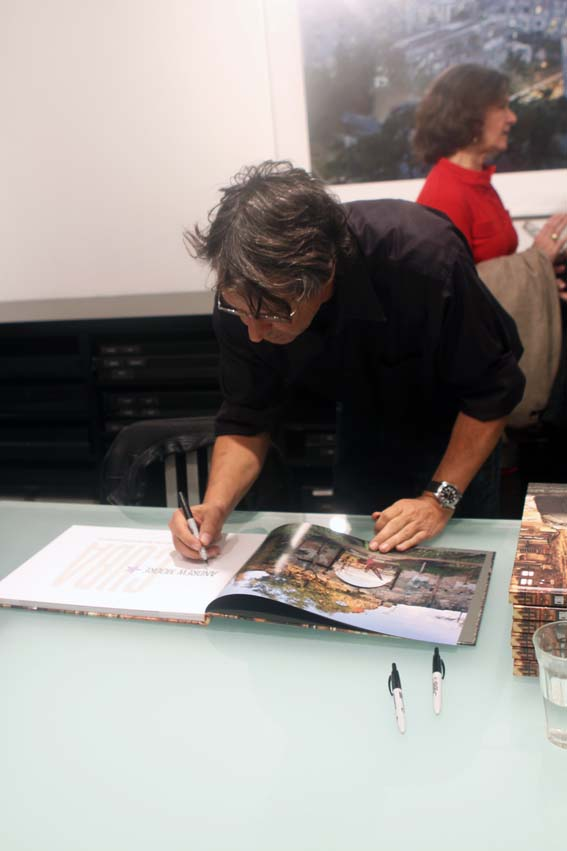"Andrew Moore signs his new book ""Cuba"" at book signing at Yancy Richardson Gallery."