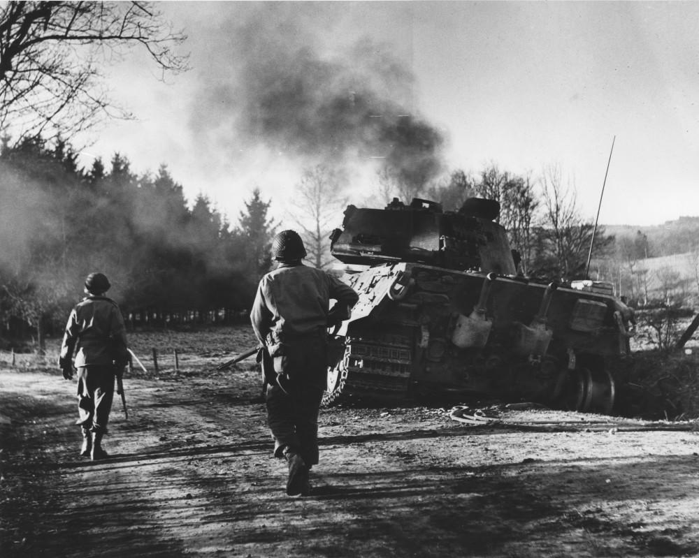 JoFl063_Outsied La Gleize, Two Infantrymen Move Move Past a Monstrous German King Tiger Tank, Dec 17, 1944