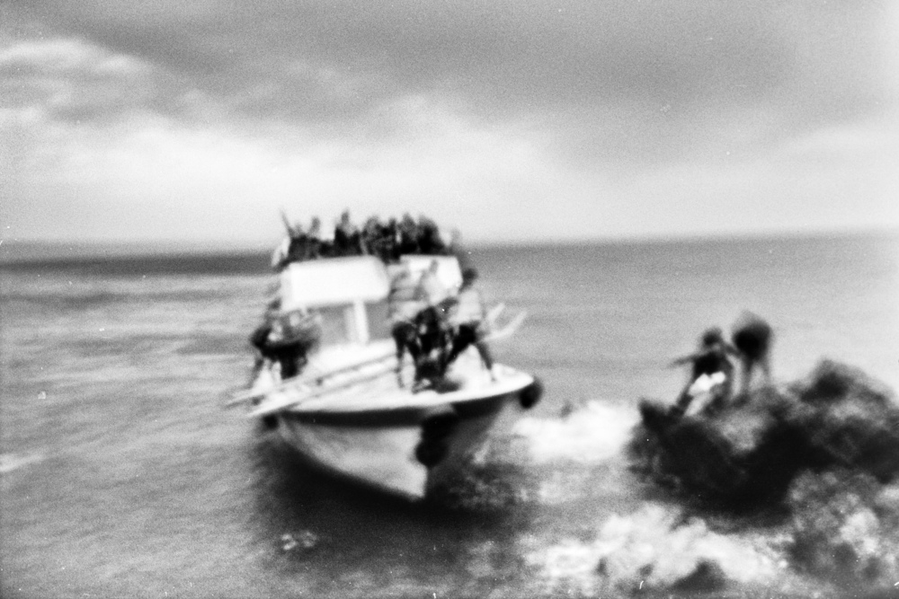 Refugees and migrants reach the coast of the tiny Greek island of Lesbos on October 11, 2015 after crossing the Aegean Sea from Turkey. According to the island's Ministry of Interior, nearly 30.000 people landed here during the first week of October alone. Most of the new arrivals are from Syria, with large contingents from Afghanistan and Iraq.