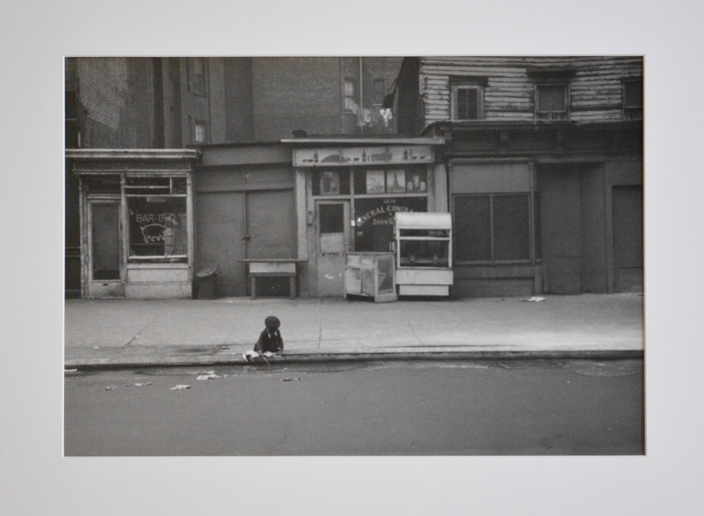 Roy DeCarava, Child Playing at Curb, Eighth Avenue, 1952, 14 1_8 x 19 7_8 in