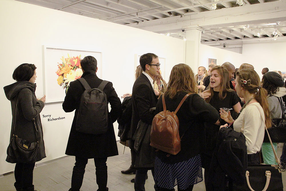 Gallery goers look at Terry Richardson's work