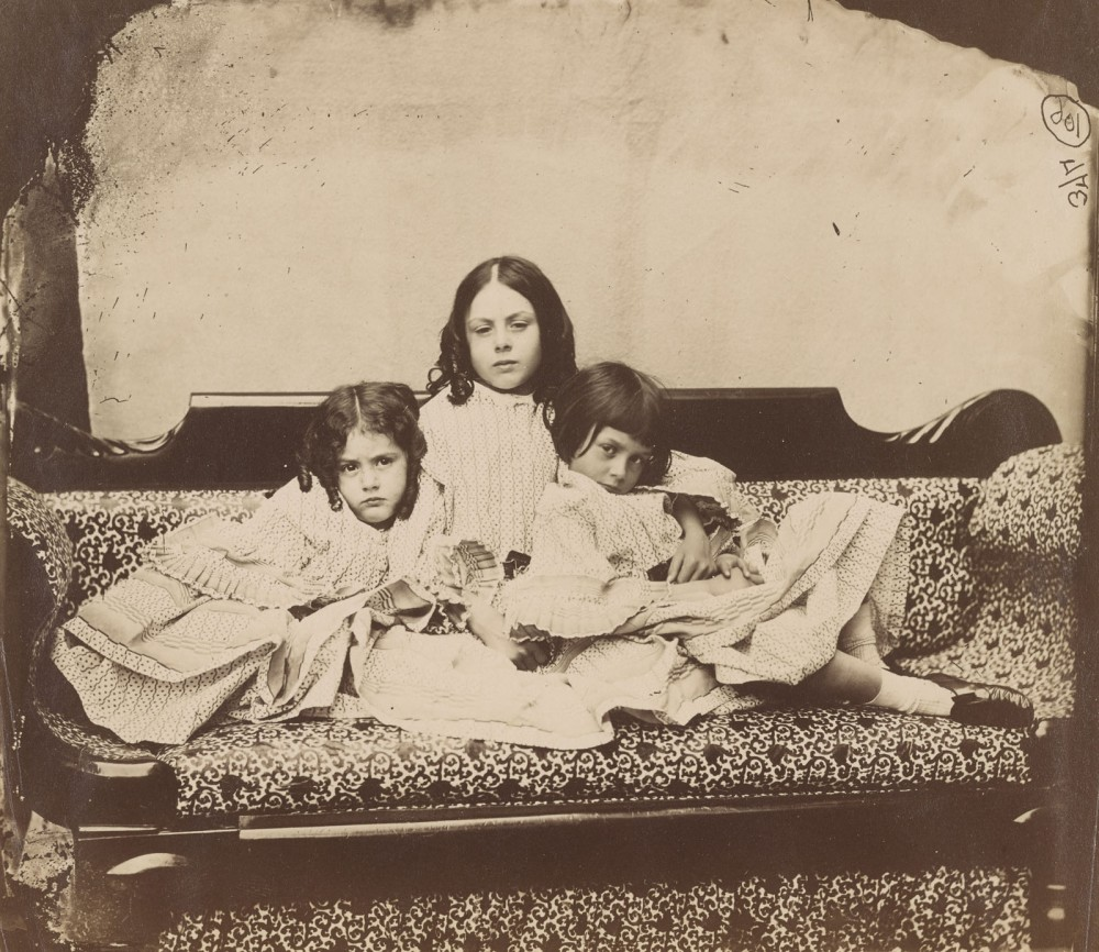 Dodgson, Charles Lutwidge, 1832-1898.   Edith, Lorina, and Alice Liddell on sofa  Summer 1858.  1 photographic print : albumen,  AAH 650
