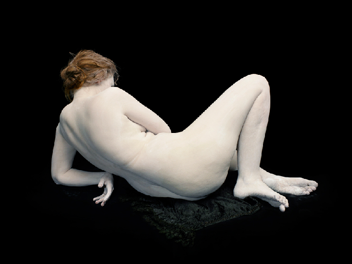 "Nadav Kander ""Audrey with Toes and Wrist Bent"". 2011."