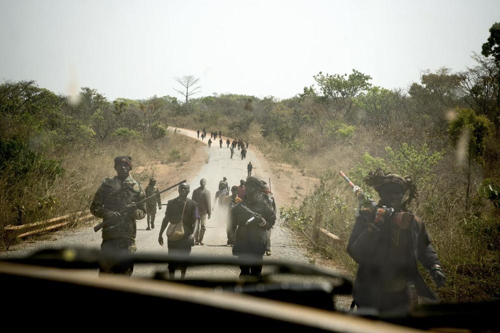 Between Bossemtpele & ZawaPart of a group of several hundred of Anti-Balaka militias return from an attack on a Peul (Fulani - a Muslim tribe) village.