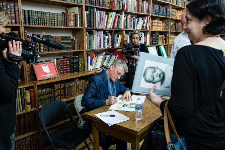 Image above: ©Elizabeth Mealey, Edward Mapplethorpe Signing His Book, 2016