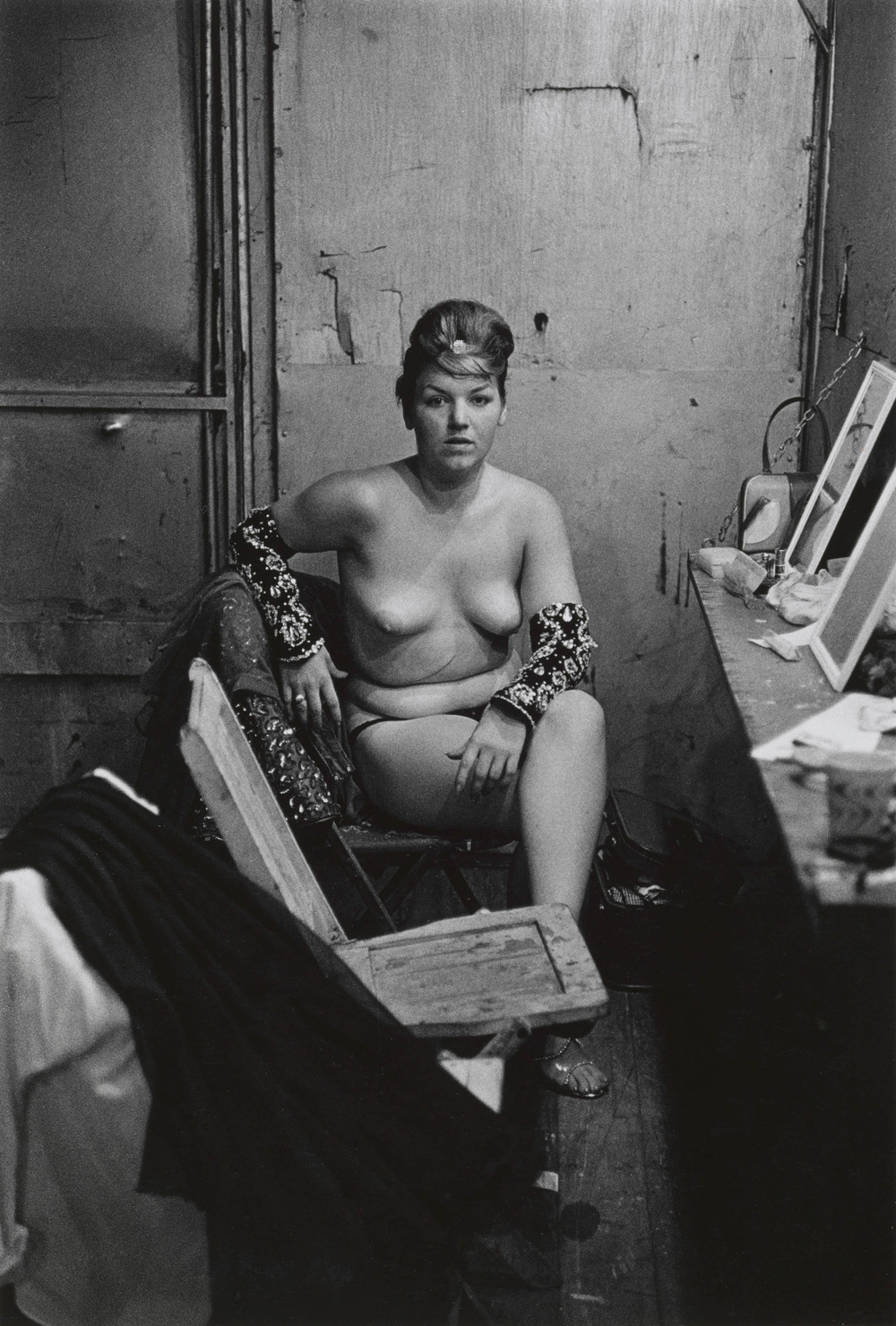 Stripper with bare breasts sitting in her dressing room, Atlantic City, N.J. 1961 © The Estate of Diane Arbus, LLC. All Rights Reserved