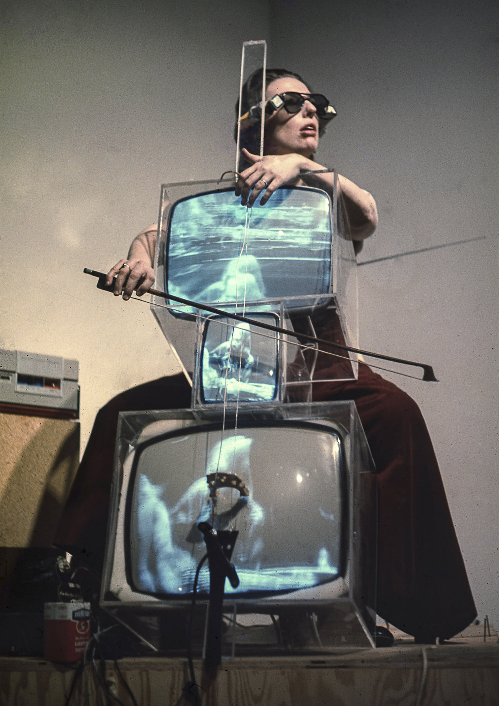 Charlotte Moorman performing on Nam June Paik's TV Cello wearing TV Glasses, Bonino Gallery, New York City, 1971, Photo: Takahiko Iimura. © Takahiko Iimura