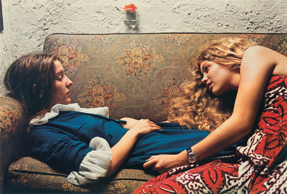 ©William Eggleston, Above Untitlted, 1974 (Karen Chatham, left, with the artist's cousin Lesa Aldridge, in Memphis, Tennessee), 1974.