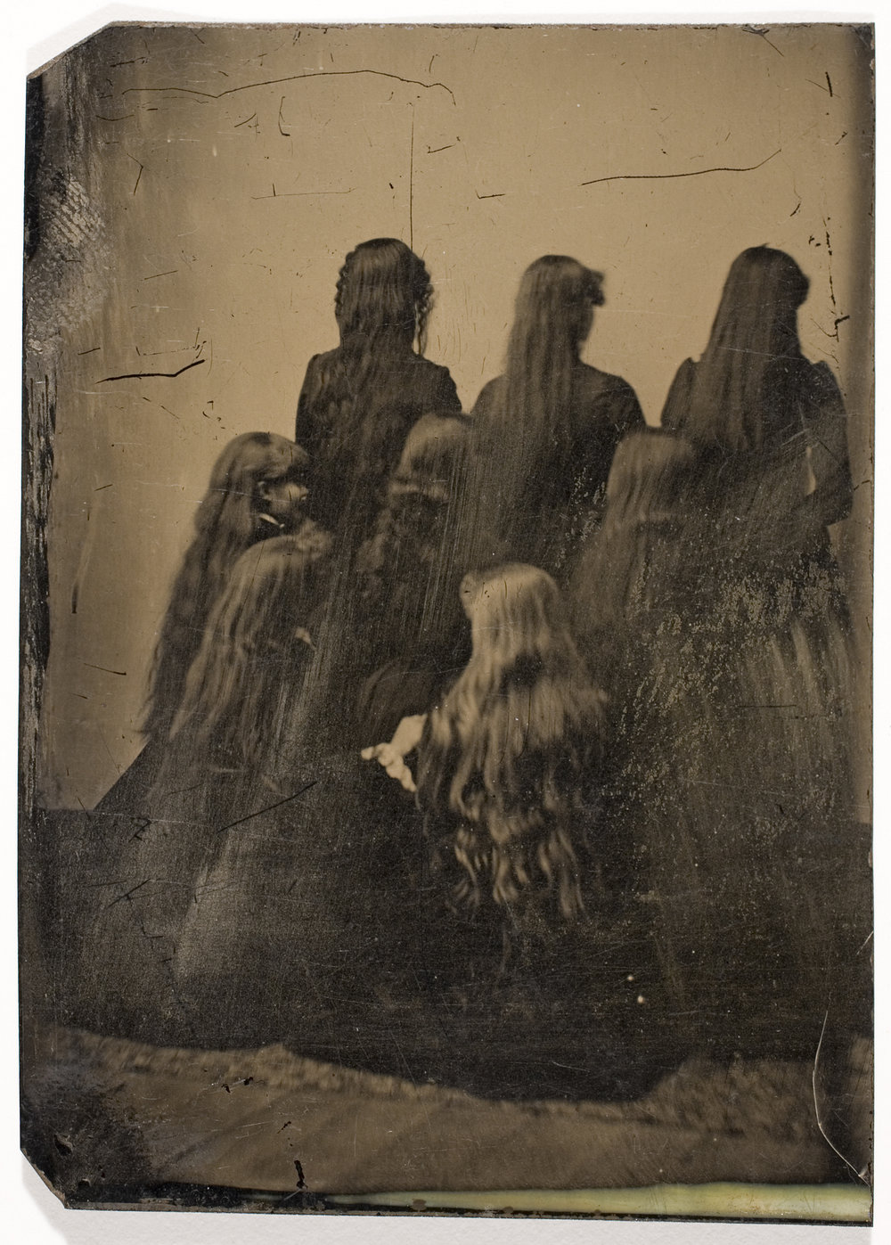 Unidentified Photographer, [Backs of Eight Unidentified Women with Long Hair],  ca. 1880. International Center of Photography, Gift of Steven Kasher and Susan Spungen Kasher, 2008 (2008.81.72)