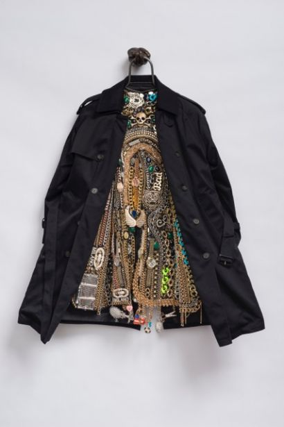 © Nick Cave  Hustle Coat  2017. Mixed media including a trench coat, cast bronze hand, metal, costume jewelry, watches and chains. Courtesy of The Armory Show