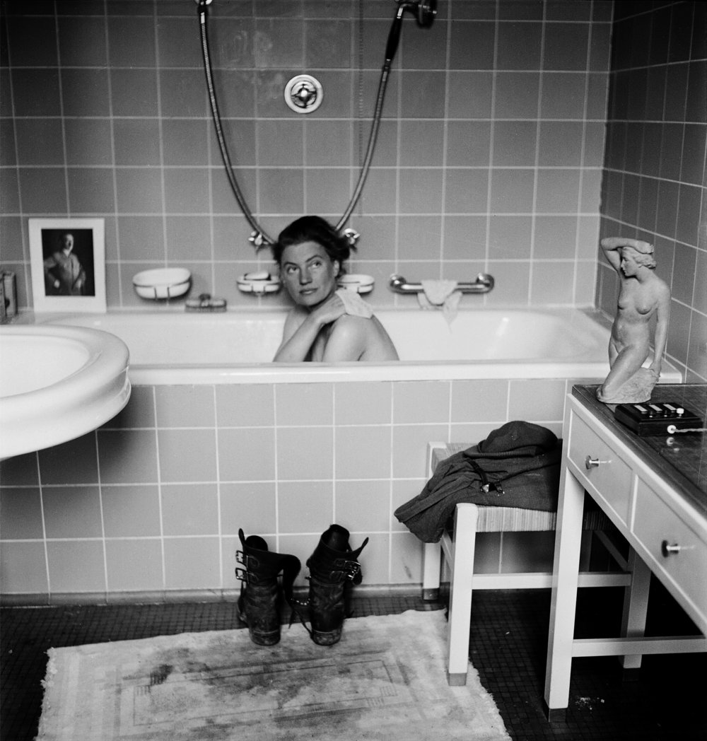 Lee Miller in Hitler's bathtub, Hitler's apartment, Munich, Germany 1945 by Lee Miller with David E. Scherman © Lee Miller Archives