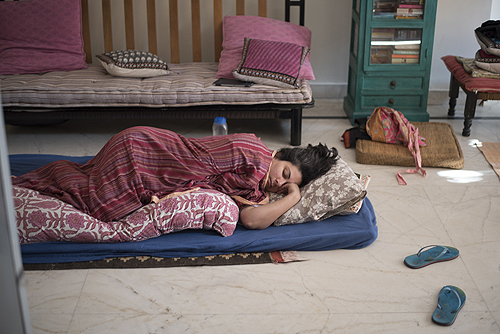 Image courtesy of Sunil Gupta & Charan Singh, Deepti, asleep in her flat, SepiaEYE,  sepiaeye.com